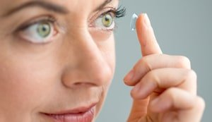 placing a contact lens on your eye